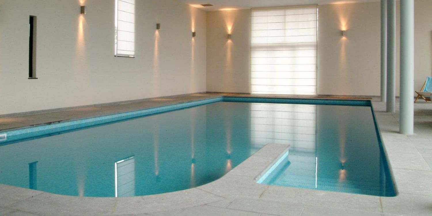 Swimming pool surround in Belgian Blue with a Pocco Veccio finish