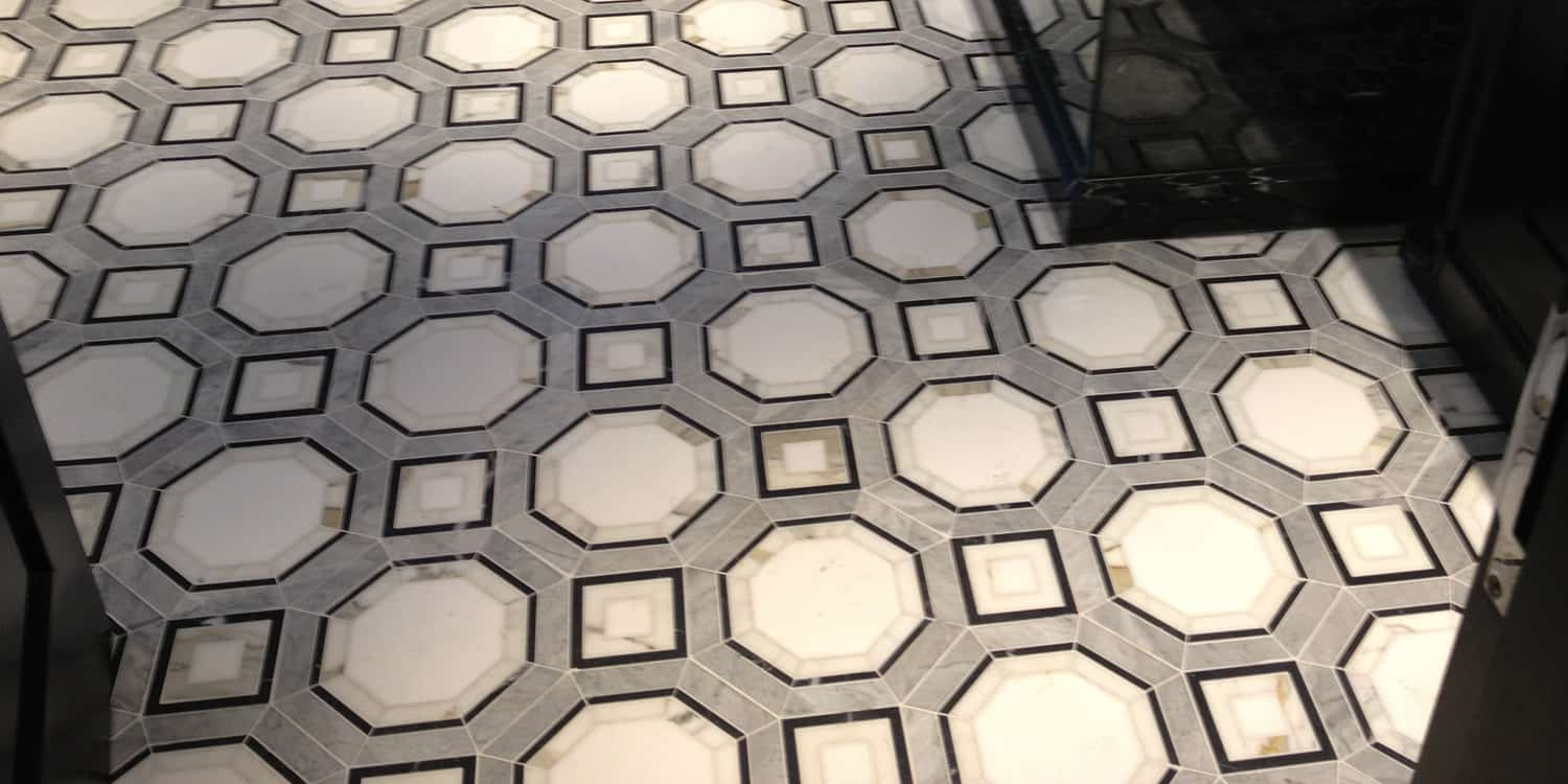 Bespoke floor made from Calacatta, Bardiglio, Thassos and Negro Marquina marble