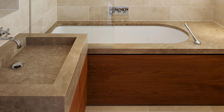 Light Emperador marble bath surround and sink