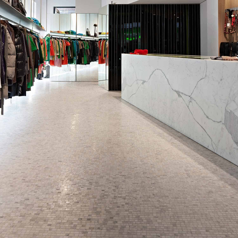 Book-matched Calacatta slabs and Carrara mosaics