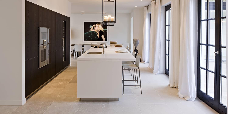 Pietra de Medici limestone flooring and white quartz worktop