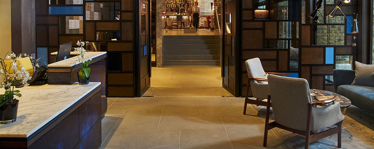 Statuario reception desk and Pietra Serena floor tiles