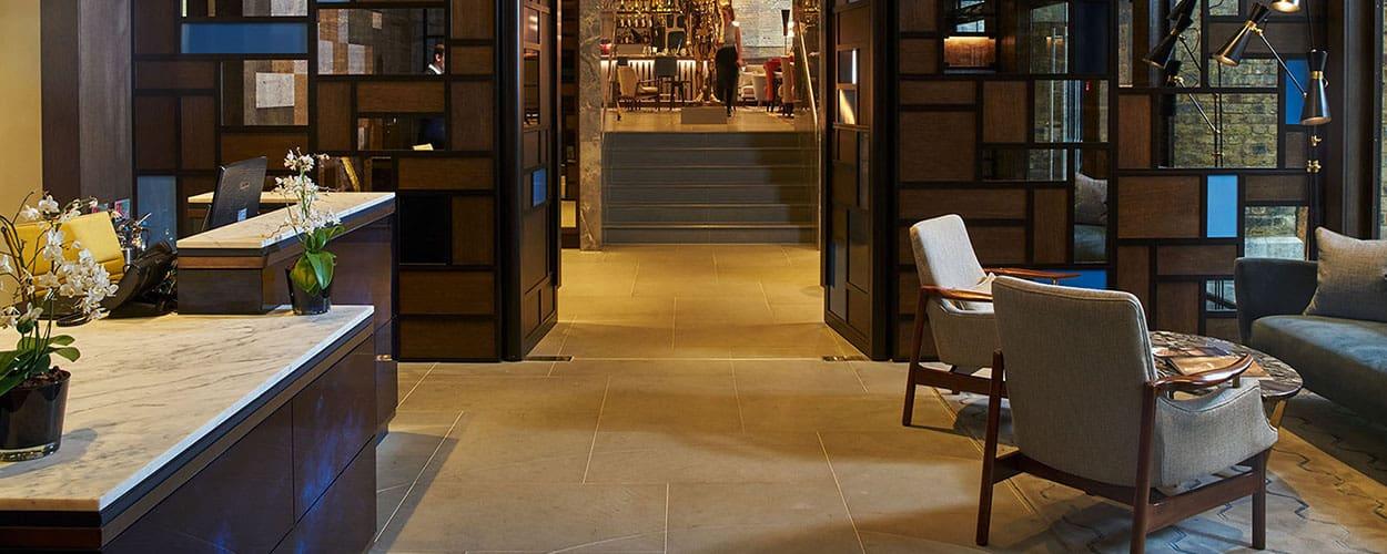 Statuario reception desk and Pietra Serena floor tiles