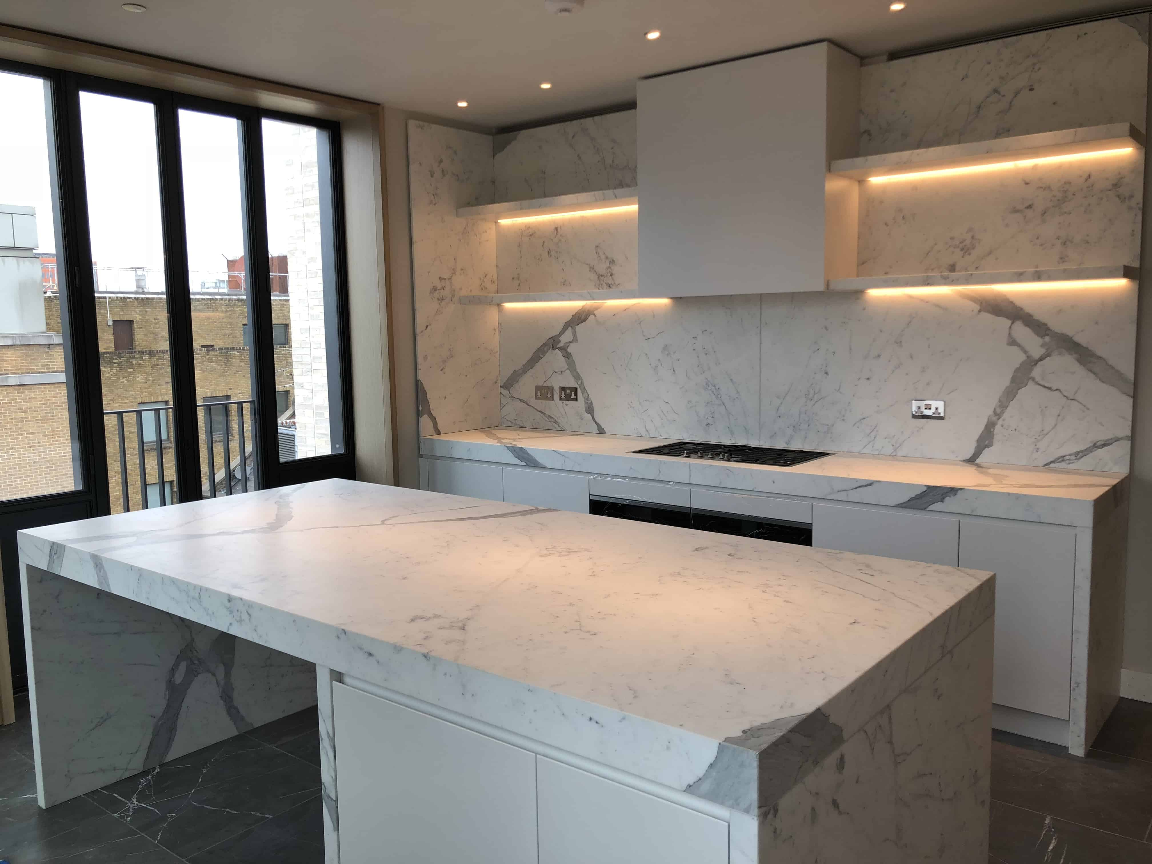 Statuario Kitchen With bookmatch upstand and shelves